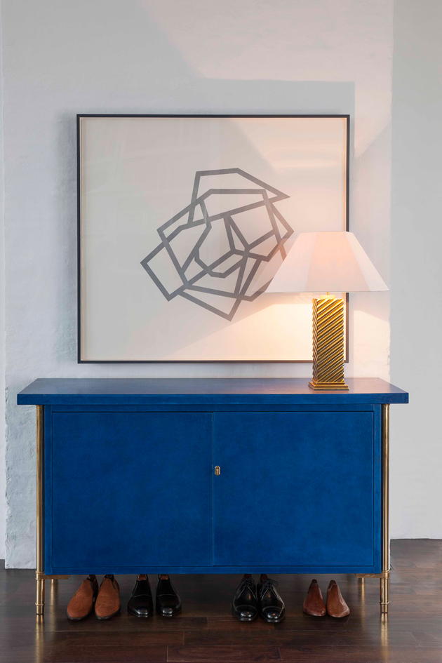 Inspired by a French 1950s design, The Rivoli Cabinet is a leather wrapped wooden cabinet made by Suffolk cabinetmakers and saddlers, with brass legs made by Essex engineers.