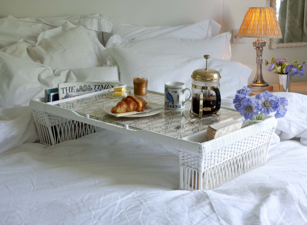 A beautiful handmade breakfast tray in rattan with glass top.  The two compartments on either side of the tray are ideal for storing newspapers, magazines and even a small bunch of flowers. Once breakfast is finished, the tray table can be elevated to enable newspapers to be read comfortably.